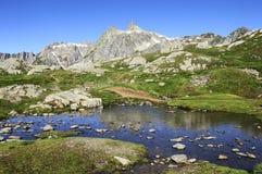 Mountain peak and lake Stock Photography