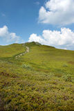 Mountain peak landscape, blue sky and white clouds Poland Stock Photography
