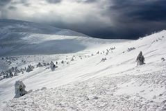 Mountain peak lanscape against snow storm. At winter mountain resort Royalty Free Stock Photo