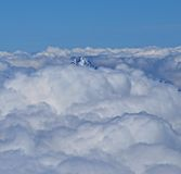 Mountain Peak. Peak of a 4000m Swiss mountain visable through the clouds Stock Photography