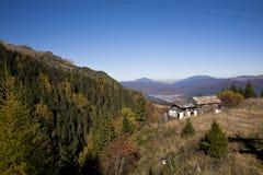 Mountain peak and meadows Stock Photos