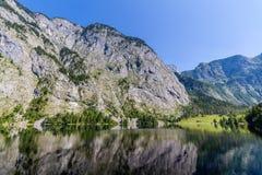 Mountain peak mirroring in lake Obersee Stock Images