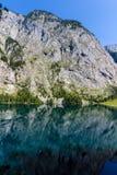 Mountain peak mirroring in lake Obersee Stock Image