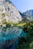 Mountain peak mirroring in lake Obersee Stock Photos