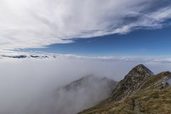 Mountain peak in mist Stock Photography