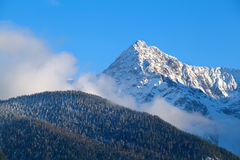 Mountain peak over blue sky Stock Image