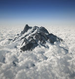 Mountain peak over the clouds. 3d illustration Mountain peak over the clouds Royalty Free Stock Image