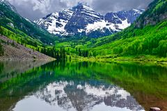 Mountain peak reflection in calm lake. Royalty Free Stock Photography