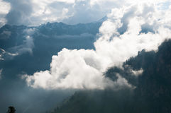 Mountain peak shrouded in clouds Stock Photography
