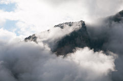 Mountain peak shrouded in clouds Stock Photo