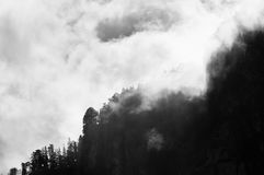Mountain peak shrouded in clouds Stock Photos