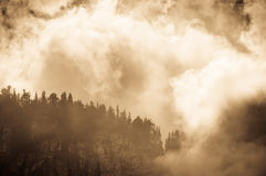 Mountain peak shrouded in clouds Stock Image