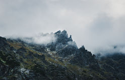 Mountain peak shrouded in storm clouds Stock Photography