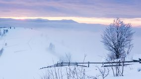 Mountain peak with snow blow by wind. Winter landscape. Cold day, with snow. stock footage