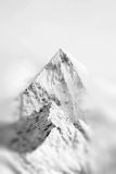 Mountain peak with snow in mist Stock Photography