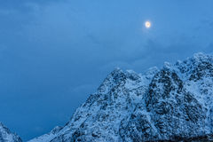 Mountain peak with snow and the Moon, Hamnoy Island, Lofoten, No Royalty Free Stock Photography