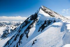 Mountain peak with snowcaps in winter. Royalty Free Stock Photo