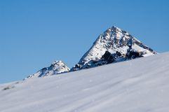 Mountain peak and snowy slope Stock Images