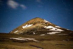 Mountain peak and stars Royalty Free Stock Photos