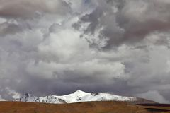 Mountain peak and stormy clouds Royalty Free Stock Images
