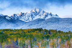 Mountain Peak at Sunrise. Sunrise on a snowy Autumn morning in the San Juan Mountains of Colorado Royalty Free Stock Image