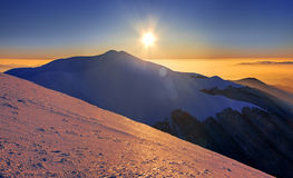 Mountain peak, sunset. In mountains, winter landscape Stock Photography