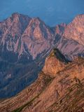 Mountain peak during sunset golden hour the swiss alps, brienzer rothorn vertical. Mountain peak during sunset in golden hour the swiss alps, brienzer rothorn royalty free stock photography