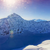 Mountain peak at Swiss Aletch glacier helicopter view in winter Royalty Free Stock Images