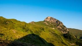 Mountain peak in Switzerland. A mountain peak and meadow in Switzerland Royalty Free Stock Photos