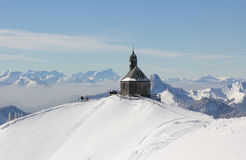Mountain peak wallberg with chapel in winter Royalty Free Stock Photo