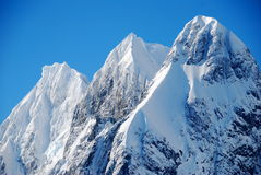 Mountain peaks. Three snow covered mountain peaks Stock Photo
