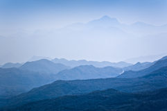 Mountain peaks. Covered with dark woods in blue mist. Montenegro Stock Images
