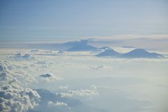 Mountain peaks above clouds Stock Image