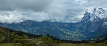 Storm covered Swiss mountains Stock Photo