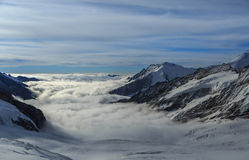 Mountain peaks above the clouds in Switzerland Royalty Free Stock Image