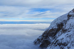 A mountain above the clouds in Switzerland Royalty Free Stock Images