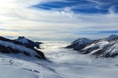Mountain peaks above the clouds in Switzerland Royalty Free Stock Photo