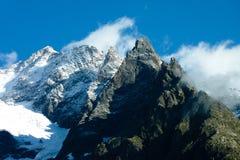 Mountain peaks against blue skies