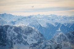Mountain peaks and aircraft. In Stock Photos
