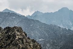 Mountain peaks bathed in clouds stock images