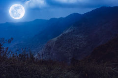 Mountain peaks with blue sky and beautiful full moon. Royalty Free Stock Photos