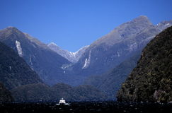 Mountain peaks and boat Royalty Free Stock Photo