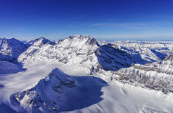 Mountain peaks chain in Jungfrau region helicopter view in winte Royalty Free Stock Photos