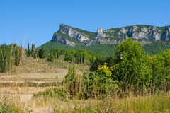 Mountain peaks and cliffs in the Drome region of Southern france. Overlooking the forest and farmland below Royalty Free Stock Photo