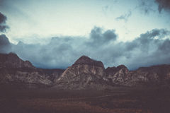 Mountain peaks with clouds Royalty Free Stock Image