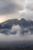Mountain peaks in clouds Royalty Free Stock Image
