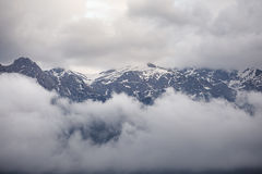 Mountain peaks in clouds Royalty Free Stock Images