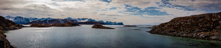 Mountain peaks covered with snow, islands and ocean in northern Norway. Sommaroy Stock Photography