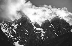 Mountain peaks cut though sunlight as it hits the clouds - Salkantay Trail - Peru Royalty Free Stock Images