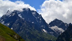 Mountain peaks of Dombay in the clouds. The Republic of Karachay-Cherkessia in the North Caucasus, Russia. Photo taken on: July 26 Friday, 2013 Stock Images